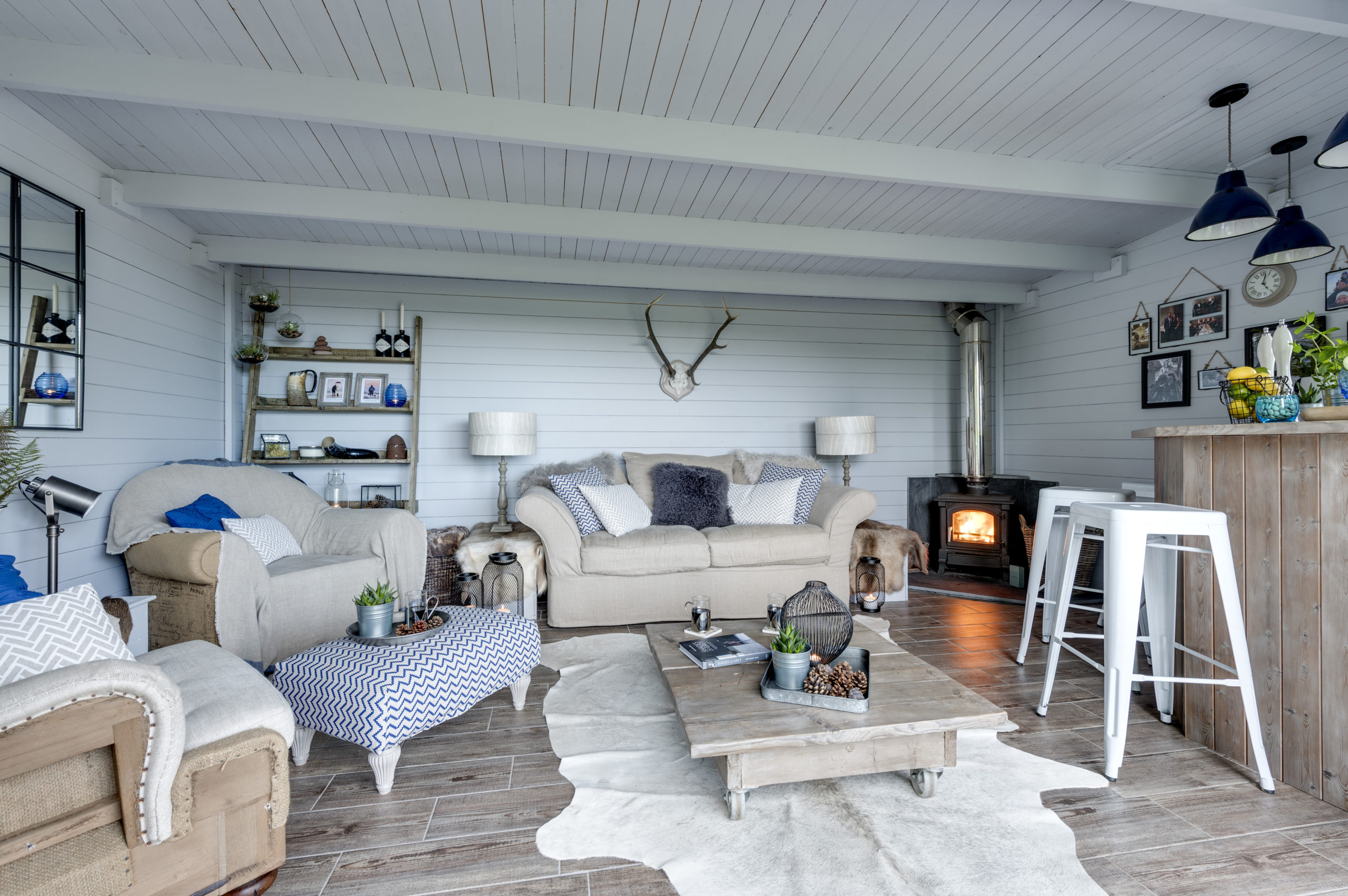 Outdoor kitchen and scandi style summerhouse designed by Amelia Wilson