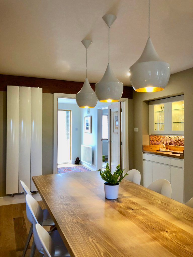 Open plan kitchen dining space designed by Amelia Wilson Interiors Ltd interior design Cumbria