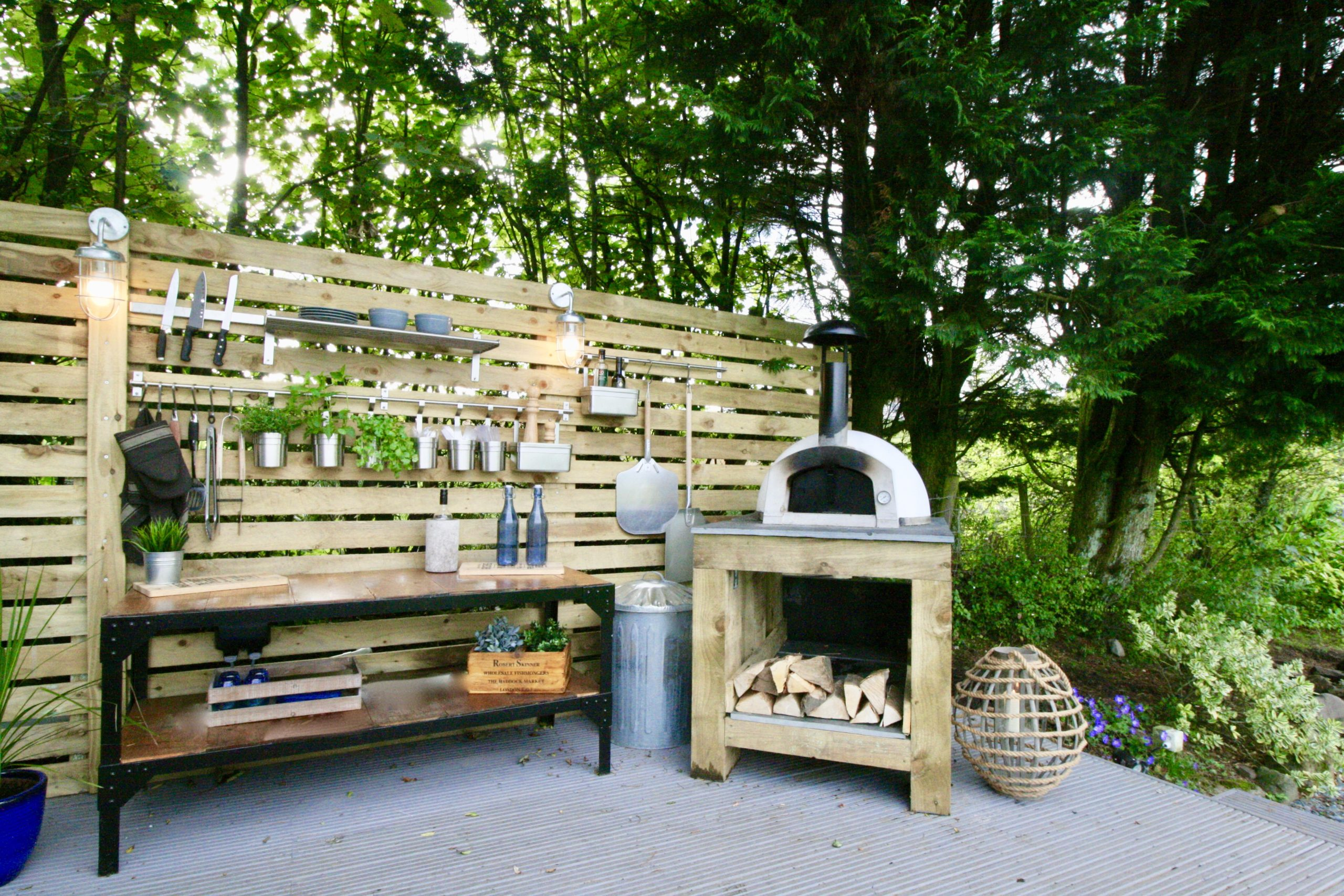 Storage and hanging space in outdoor kitchen