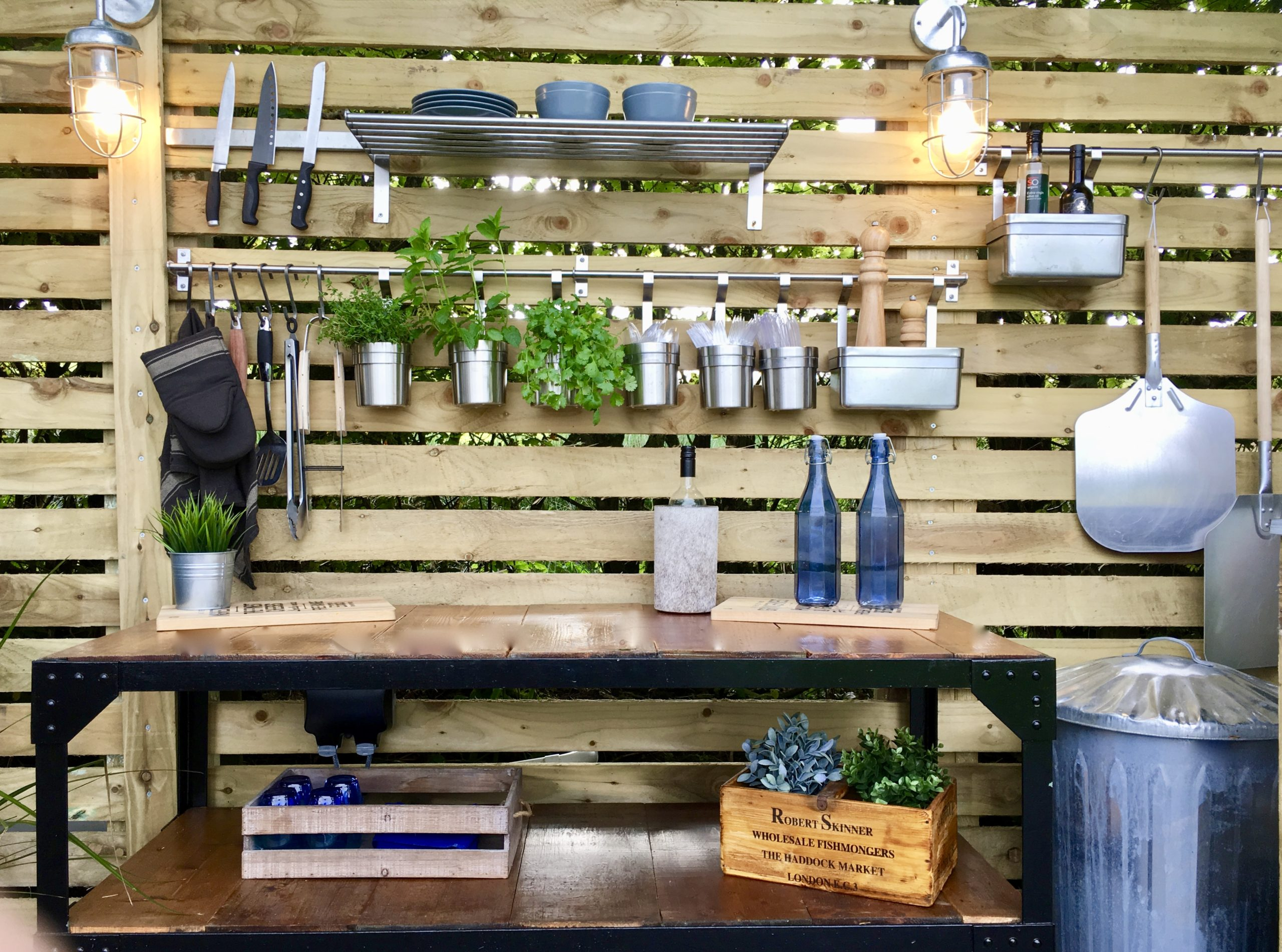 Industrial style metal table in outdoor kitchen