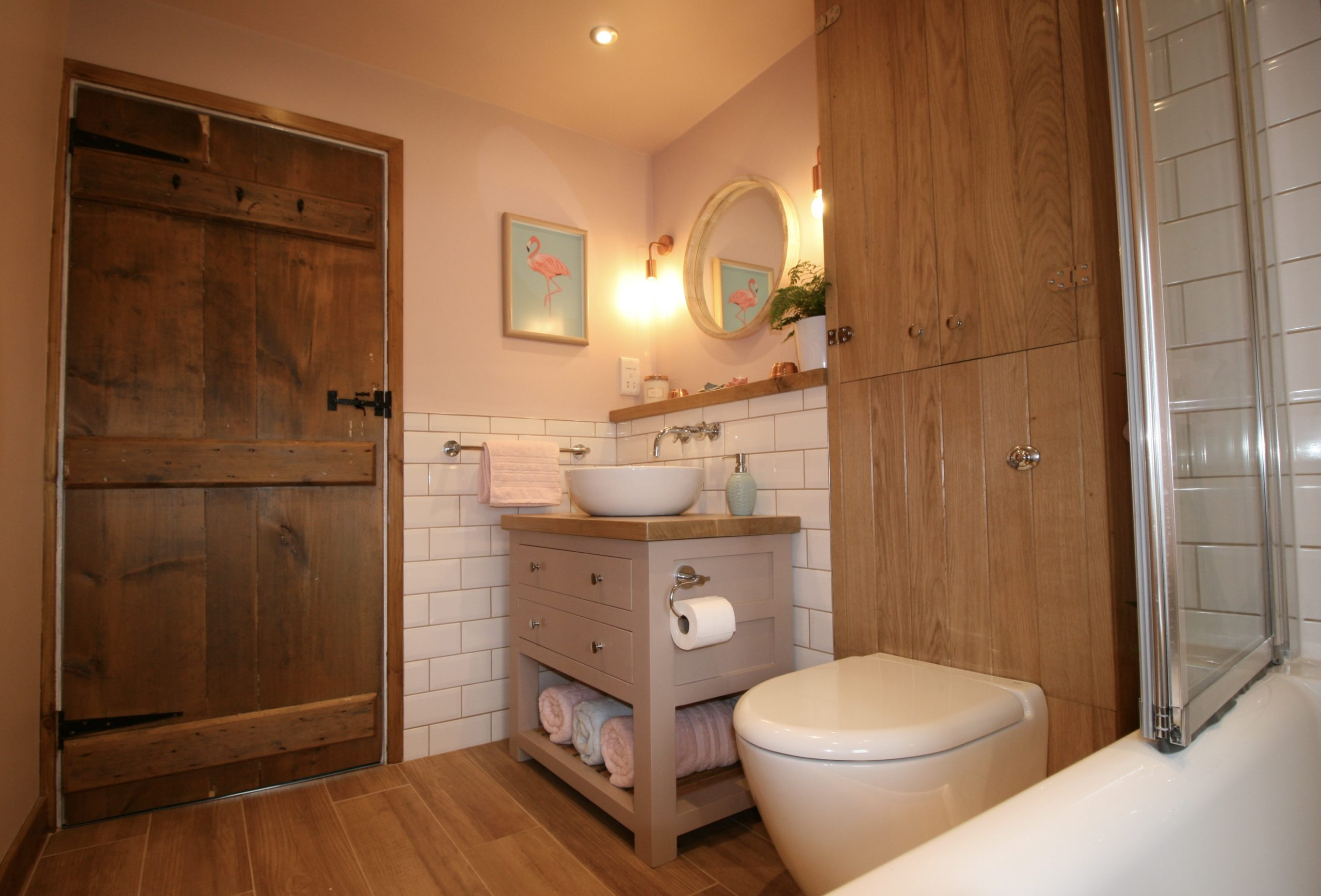 Bathrooms - Modern country style pastel pink bathroom with copper lights and painted vanity unit by Amelia Wilson Interiors