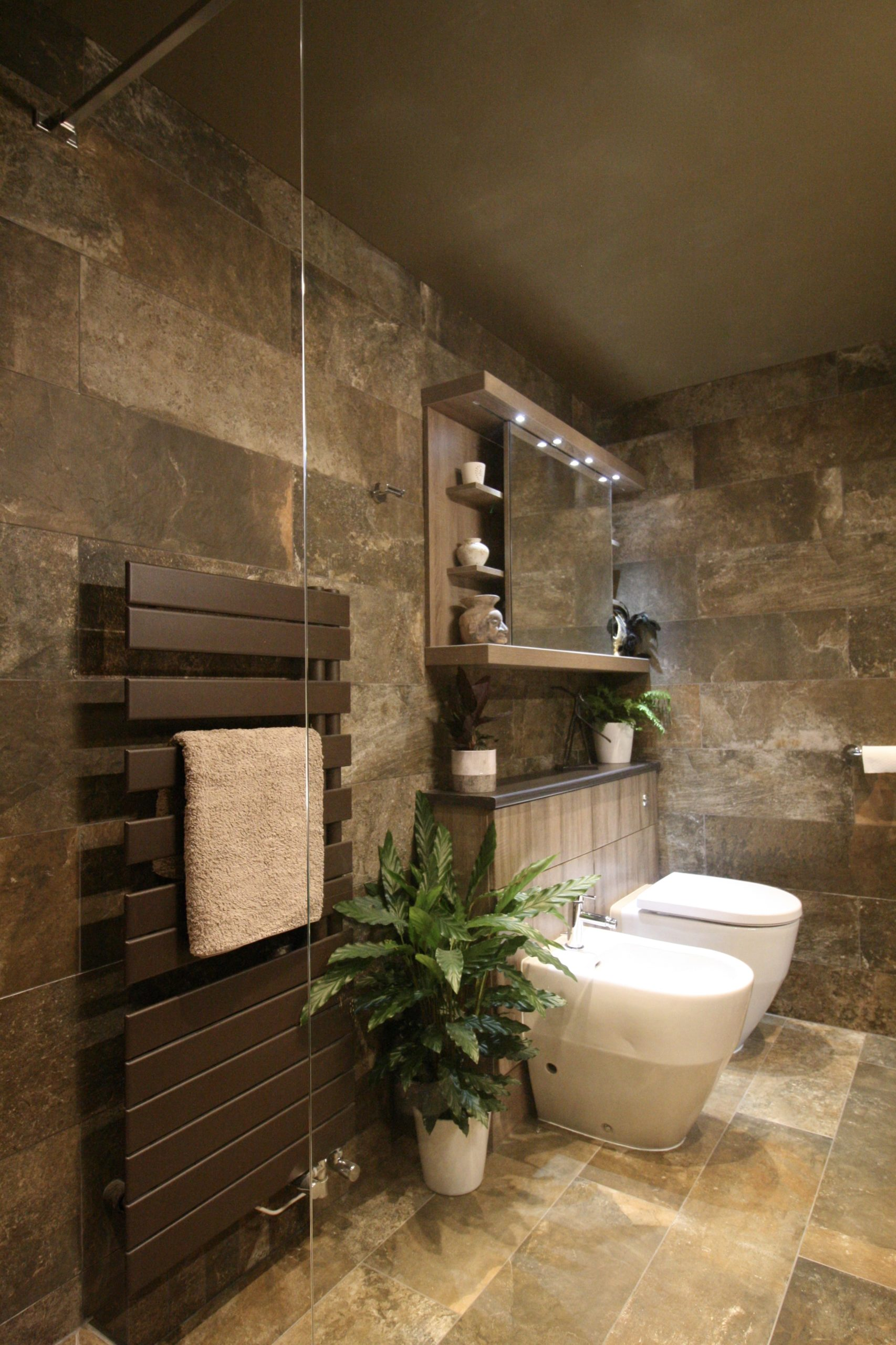 Contemporary towel radiator in contemporary shower room by Amelia Wilson