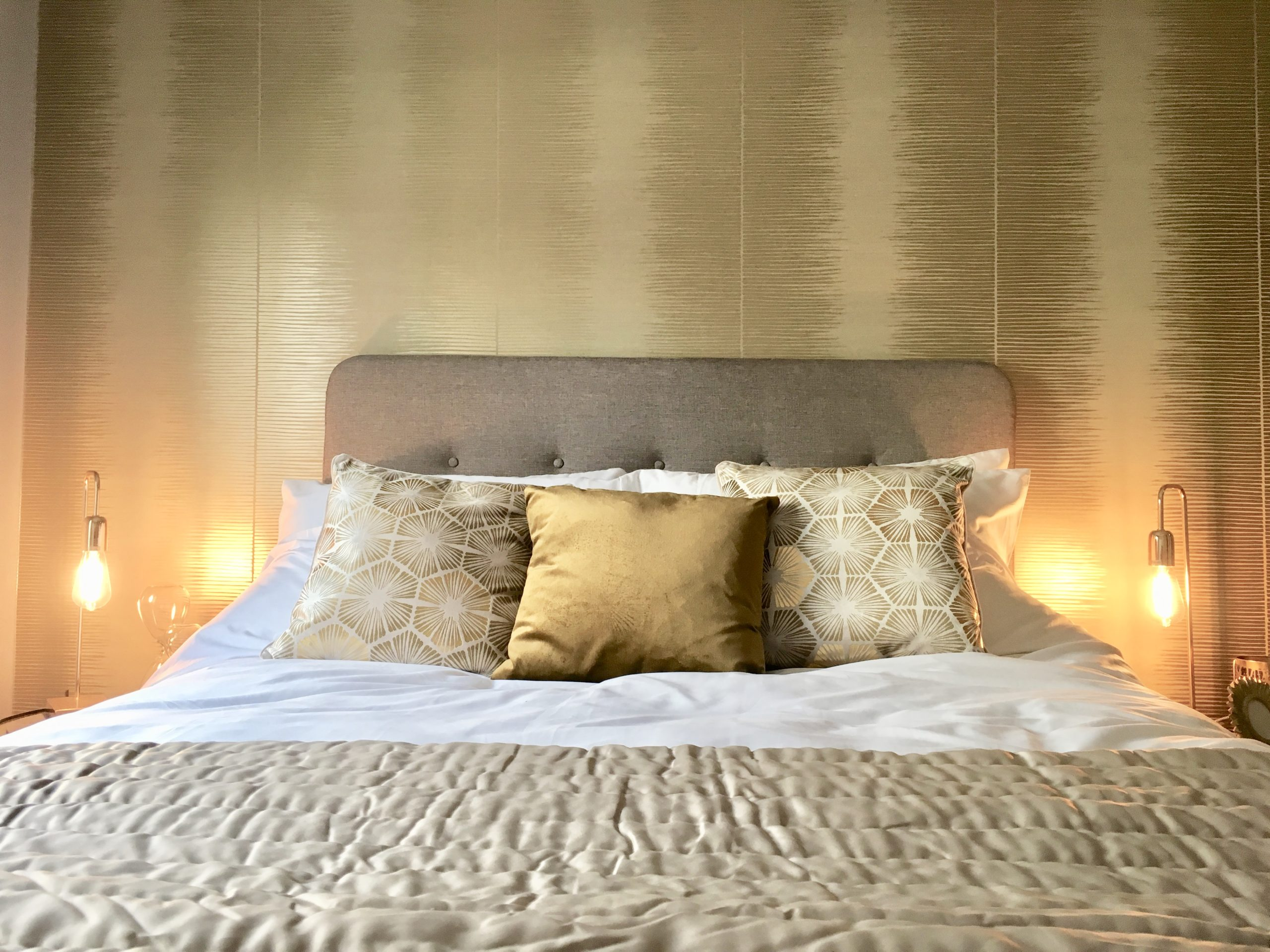 Gold Plume wallpaper by Cole and Son in show home bedroom designed by Amelia Wilson Interiors Ltd