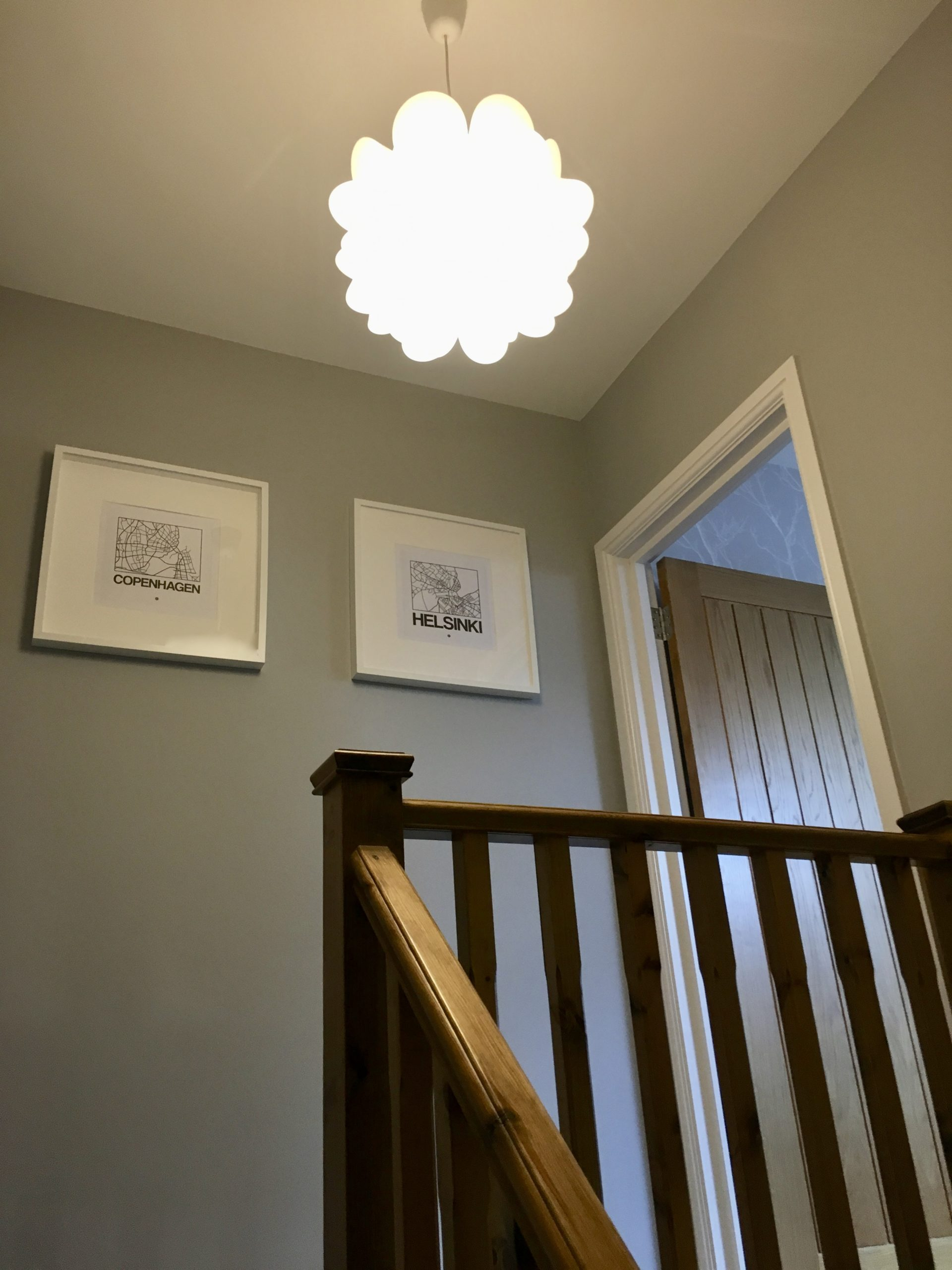 Scandinavian city map prints in show home designed by Amelia Wilson Interiors Ltd