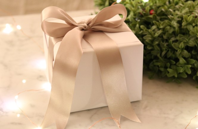 white gift box wrapped with oyster silk ribbon