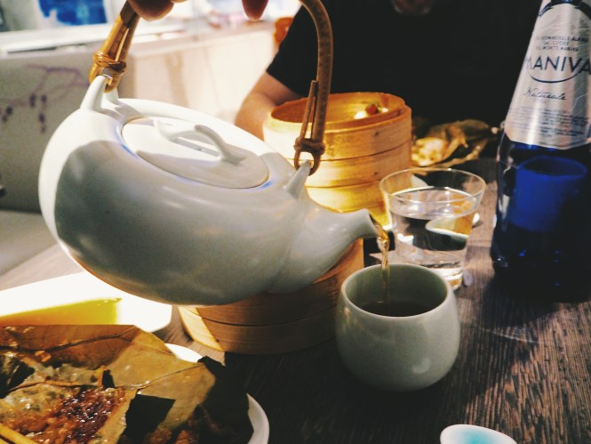 Chinese tea being poured from blue teapot