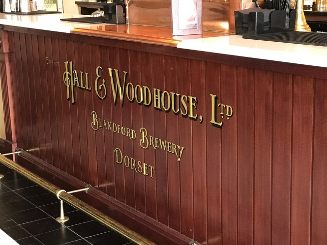 Hall and Woodhouse sign