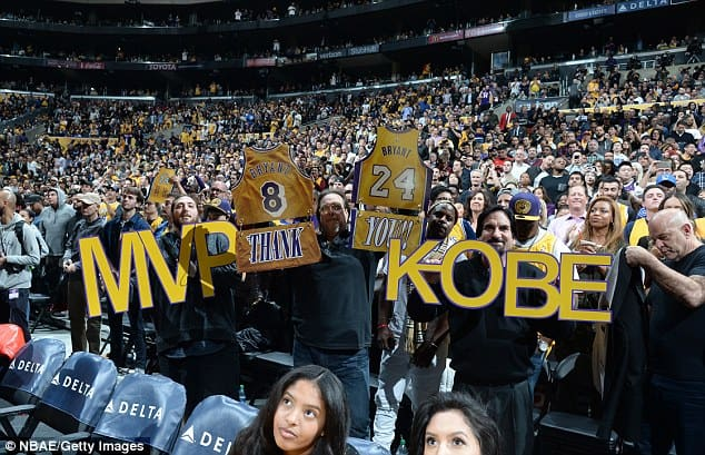 "fans hold up ""MVP Kobe""in support of Kobe Bryant [www.AmenRadio.net]"