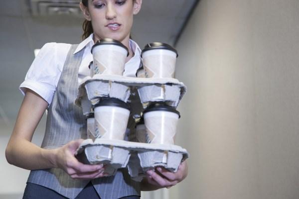 Coffee Vending Machine- Person holding coffee