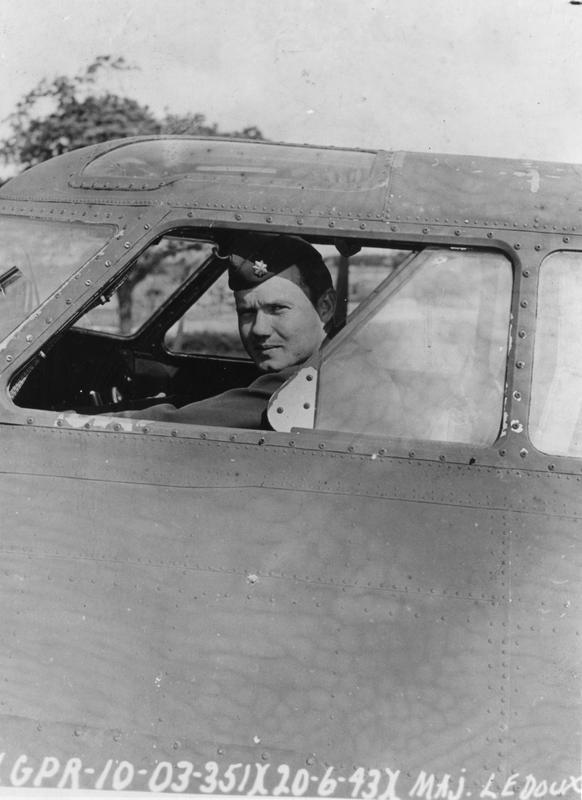 Major LeDoux, commanding officer of the 351st Bomb Group the cockpit of a B-17 Flying Fortress, 20 June 1943. Official caption on image: