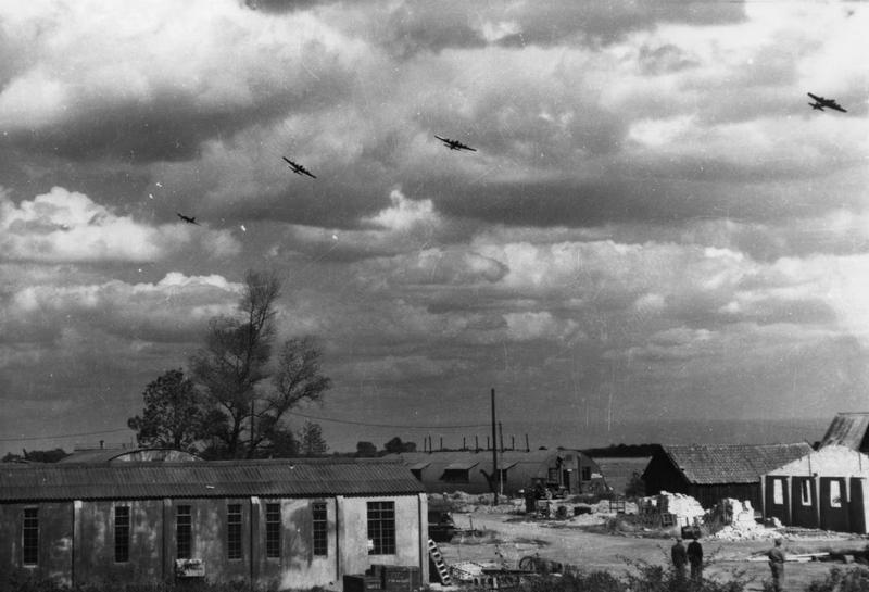 B-17 Flying Fortresses of the 390th Bomb Group in flight over Framlingham. Handwritten caption on reverse: '390BG.'