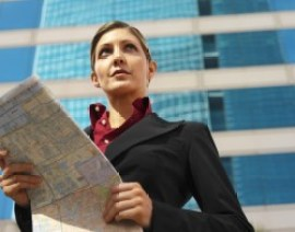 Woman With Map On Compliance Management Software Page