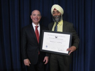 "USCIS Director Alejandro N. Mayorkas presents Amarpreet S. Sawhney, President and CEO, Ocular Therapeutix, Inc., with the ""Outstanding American by Choice"" recognition in Washington, DC, on May 29, 2013"