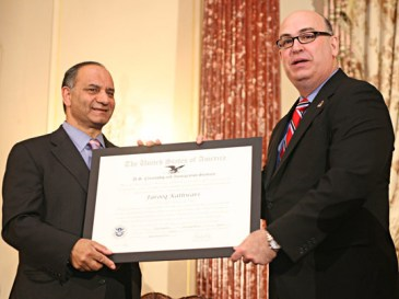 "USCIS Director Emilio T. González presents Farooq Kathwari with the ""Outstanding American by Choice"" recognition in Washington, DC, Apr. 23, 2007"