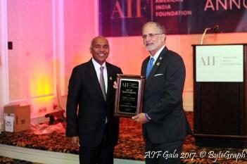Ambassador Charles Shapiro being recognized by Harsha Agadi