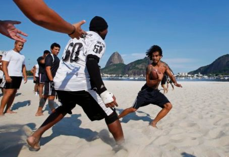 Botafogo Mamutes players play football during a training session on Botafogo beach in Rio de Janeiro