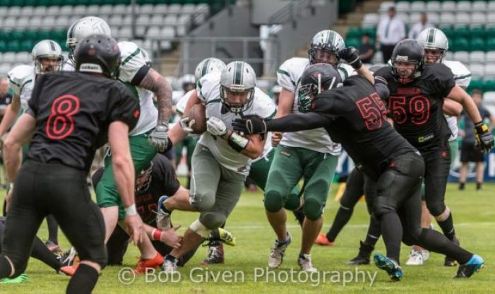 Full Back, Neil Montgomery storms through for the touchdown. Photography by Bob Given