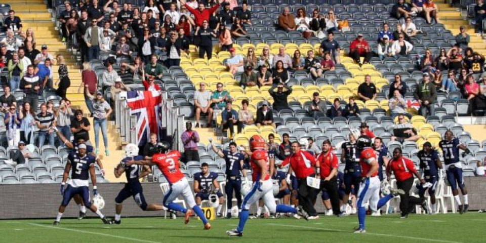 Great Britain #20 Josh Amis goes 65 yards for the punt return touchdown. Photo: Biff Crabbe