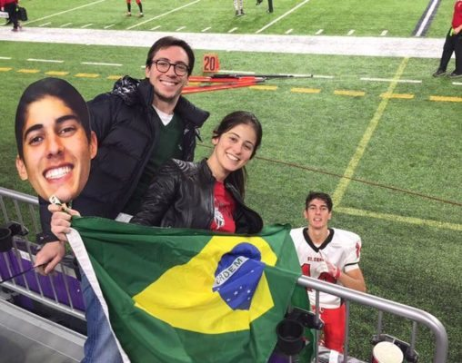 Thiago Ribeiro, of Uberlândia, Minas Gerais, Brazil, gets some love from Brazilian American football fans who came to watch St. Croix's state semifinal victory at the Minnestoa Vikings US Bank Stadium.