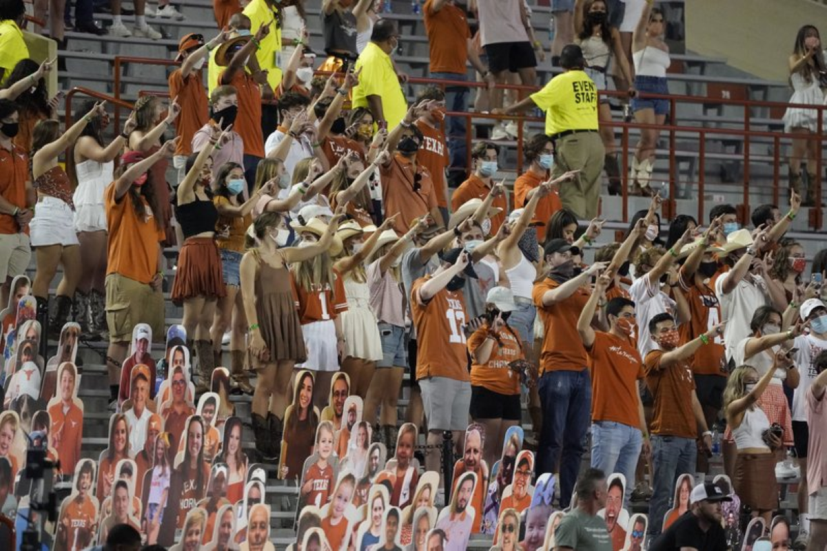 NCAA-2020-Fans-join-in-singing-The-Eyes-of-Texas-after-Texas-defeated-UTEP-59-3-in-an-NCAA-college-football-Photo-AP-Photo-Chuck-Burton-File.png?fit=1200%2C800&ssl=1