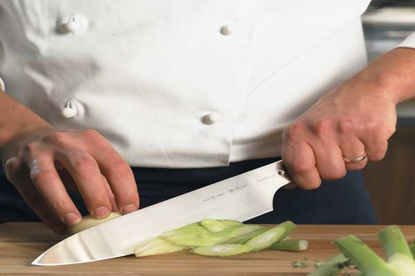 The claw grip for holding chefs knife