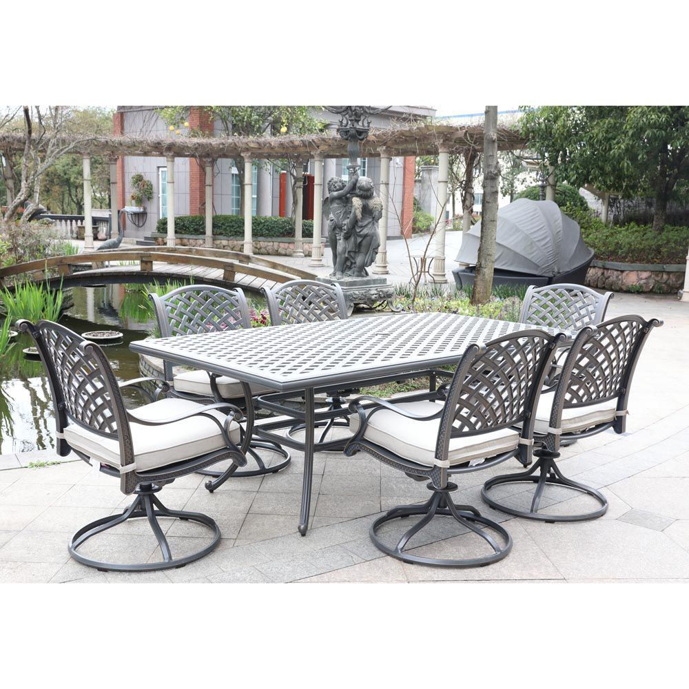 silver outdoor 7 piece dining set with six swivel chairs