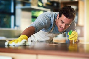 contractor man cleaning and spraying a flat space   American Home Services   Pest free home Orlando