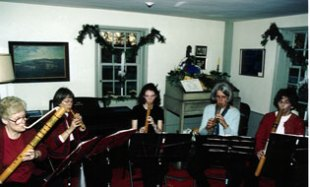 American pipers play during a Holiday Open House in December 2001 at the Buckman Tavern in the room where the Minutemen met before the battle of Lexington. Pipers have played at open houses in Lexington for over 15 years.