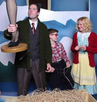 """""""A Christmas Story,"""" adapted by Benj Pasek, Justin Paul and Joseph Robinette from the film, at the The Rose Theater Omaha, Neb., through Dec. 28. Pictured: Konrad Case, Dave Wingert and Angela Jenson-Frey."""
