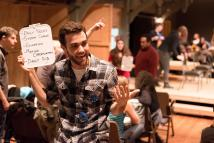 """""""How to End Poverty in 90 Minutes,"""" created by Michael Rohd and Sojourn Theatre, at Portland Playhouse in Portland, Ore., through Feb. 22. Pictured: Alex Tey. (Photo by Brud Giles)"""
