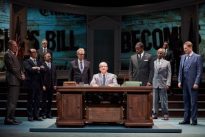 """All the Way"" by Robert Schenkkan, at Cleveland Play House in 2016. Pictured: Stephen Bradbury, Chris Richards, Greg Jackson, Timothy Crowe, Steve Vinovich (Lyndon Baines Johnson), Jason Bowen, Charles E. Wallace, and Donald Carrier. Background, from left to right: Eddie Ray Jackson, Jeffrey Grover, Joshua David Robinson, and Biko Eisen-Martin. (Photo by Roger Mastroianni)"