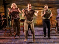 """""""Come From Away"""" by Irene Sankoff and David Hein, at Seattle Repertory Theatre through Dec. 13. Pictured: Astrid Van Wieren, Caesar Samayoa, and Chad Kimball. (Photo by Jim Carmody)"""