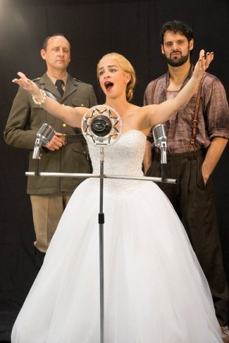 """Evita,"" by Andrew Lloyd Webber and Tim Rice, at San Diego Repertory Theatre in San Diego, Calif., through Aug. 27. Pictured: Jason Maddy, Marisa Duchowny, and Jeffrey Ricca."