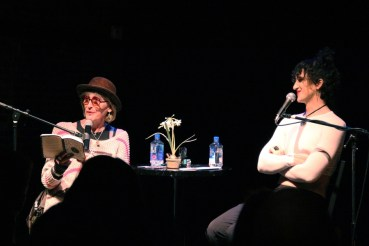 """Kate Bornstein and Theda Hammel performing in """"La MaMa's Squirts: Generations of Queer Performance"""" at La MaMa in New York City."""