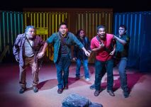 """""""American Night"""" by Richard Montoya, at Milagro (Miracle Theatre Group) in Portland, Ore., through May 23. Pictured: Ozvaldo Gonzalez (center) and cast."""