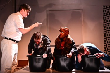"""""""The Terrible"""" by Morgan McNaught, a production from The New Colony at The Den Theatre in Chicago through Nov. 21. Pictured: Andrew Hobgood, Jessica London-Shields, Shariba Rivers, and Chris Fowler. (Photo by Evan Hanover)"""