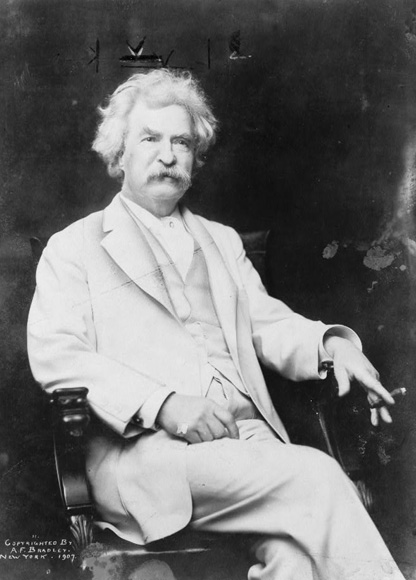 Mark Twain in 1907 - A.F. Bradley, New York, copyright, Mark Twain, three-quarter length portrait, seated, facing slightly right, with cigar in hand 1907. Prints and Photographs Division, Library of Congress