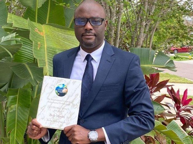 Bob Mwiti with an award