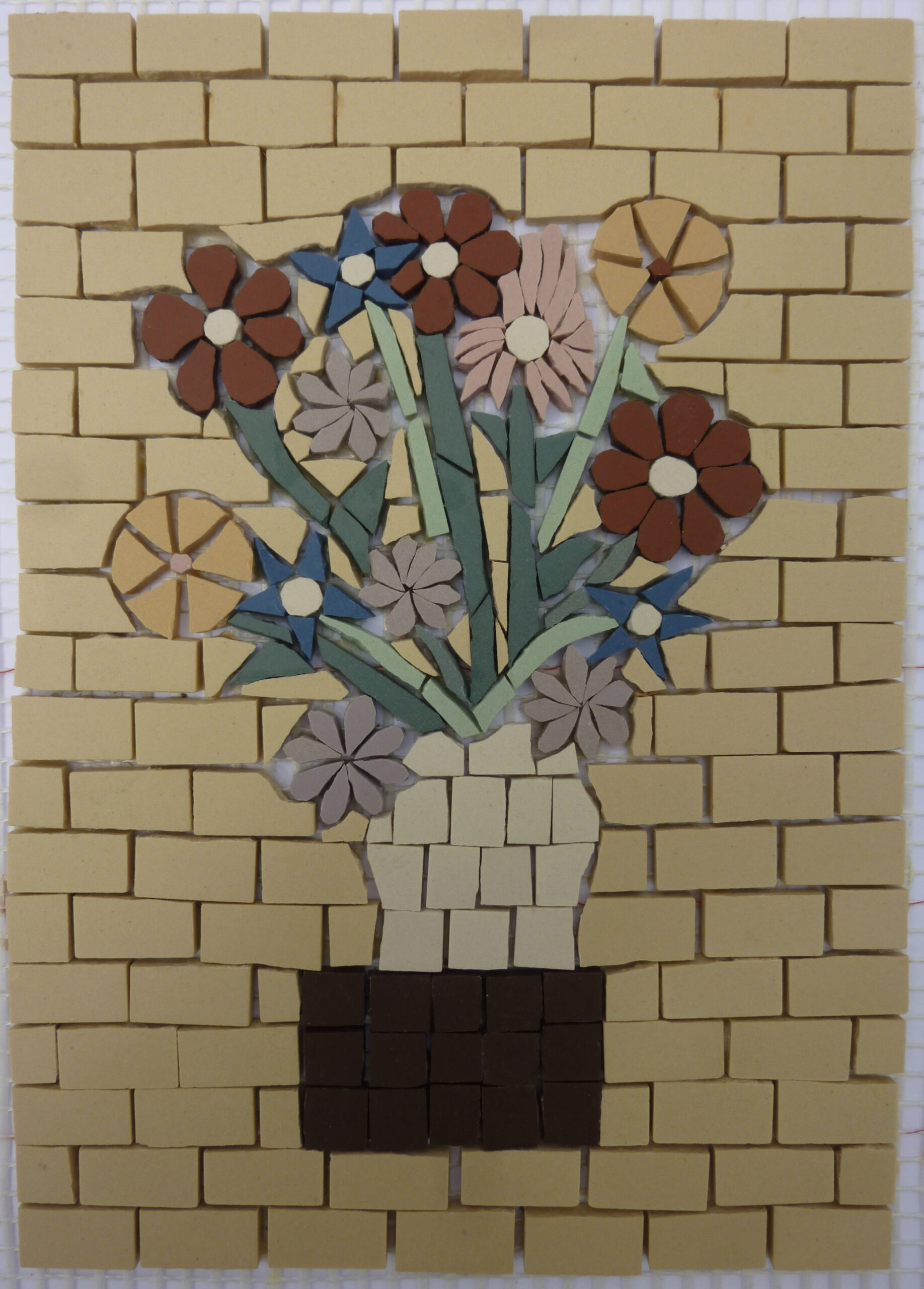 Image of a small ceramic mosaic of flowers in a vase