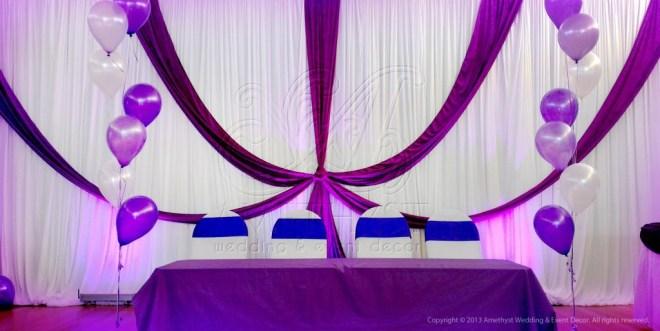 purple arch swag backdrop