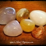 From top left: lithium quartz, citrine, pink calcite, rose quartz, orange calcite, sunstone