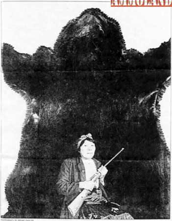 Bella Twin Is Shown With The Hide From The World Record Grizzly Bear, Shot With A .22 Caliber Rimfire Rifle, While Hunting in Alberta, Canada