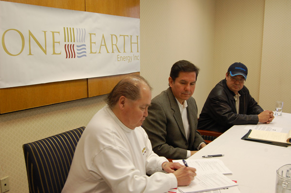 Chief Gerry Ermineskin signs the  agreement as the other signatories Blaine Favel