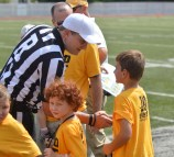 Jeremy Schneider/jeremy.schneider@amnews.com Perryville resident and pediatric cancer survivor Jack Schneider shakes hands with the referee prior to the start of Saturday's Gold Out Game at Centre.