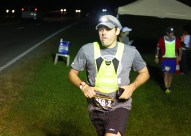 """Ben Kleppinger/ben.kleppinger@amnews.com A runner with the team """"Run, Rest, Eat, REPEAT"""" begins running a leg of the Bourbon Chase near the Lincoln-Boyle county line along U.S. 150 Friday night."""