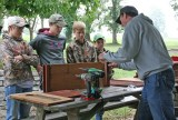Kendra Peek/kendra.peek@amnews.com Hagan Harrison, Caleb Kernodle, Brady Graves and Gabe Cruse listen to Will Bacon give directions on how to build a nesting box for wood ducks.