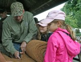 kendra Peek/kendra.peek@amnews.com Lily and Ally Mayes watch their dad, Chris Mayes, as he cuts the liner for the nesting tube for the ducks.