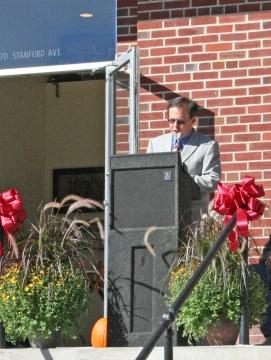 Kendra Peek/kendra.peek@amnews.com Wayne Koehler, the president of National Housing Associates, Inc., speaks to those attending the grand opening of the Goodall Apartments in Danville.