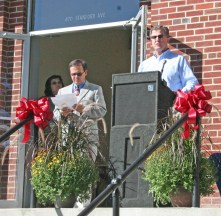 Kendra Peek/kendra.peek@amnews.com Jody Lassiter, director of the Danville-Boyle County Economic Development Partnership, speaks at the grand opening of the Goodall Apartments on Stanford Avenue in Danville, while Wayne Koehler, president of National Housing Associates, listens nearby.