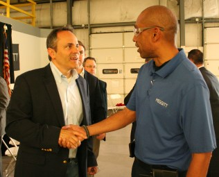 Kendra Peek/kendra.peek@amnews.com Gov. Matt Bevin shakes hands with Kevin Gaud, electrical engineer for the repair facility at Meggitt